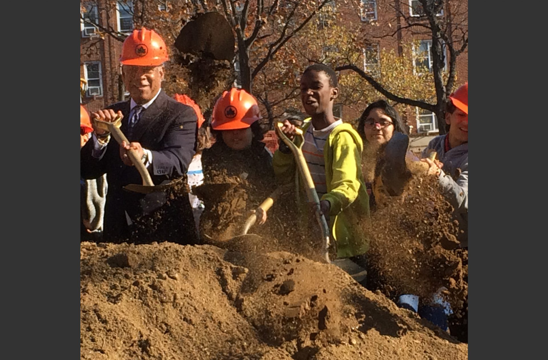 Parks Commissioner Mitchell Silver breaks ground at Lyons Square with the help of local students